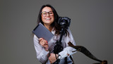 Female photographer holds tripod and tablet PC. - 171126998