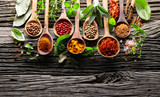 Herbs and spices on a wooden background - 171138510