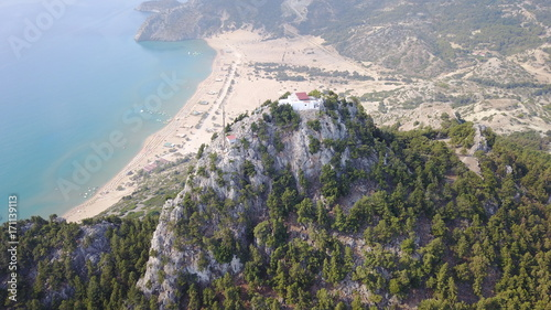 Aluminium Khaki August 2017: Aerial drone photo of famous Tsabika monastery overlooking iconic Tsabika bay from the cliff with clear turquoise waters, Rhodes island, Aegean, Dodecanese, Greece