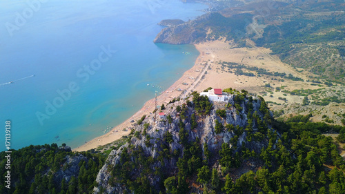 Papiers peints Bleu jean August 2017: Aerial drone photo of famous Tsabika monastery overlooking iconic Tsabika bay from the cliff with clear turquoise waters, Rhodes island, Aegean, Dodecanese, Greece
