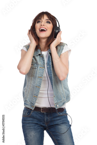 Fototapeta Singing Young Woman In Headphones