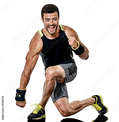 Wall mural one caucasian fitness man exercising cardio boxing exercises in studio  isolated on white background
