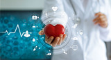 Medicine doctor holding red heart shape in hand and icon medical network connection with modern virtual screen interface in laboratory, medical technology network concept - 171149307
