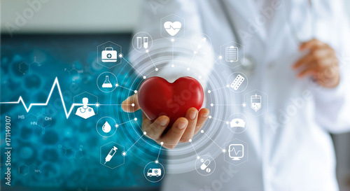 Medicine doctor holding red heart shape in hand and icon medical network connection with modern virtual screen interface in laboratory, medical technology network concept © ipopba