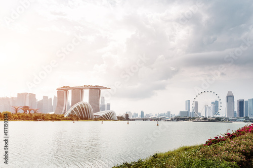 modern buildings near water in midtown of modern city in cloud sky