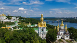Aerial top view of Kiev Pechersk Lavra churches on hills from above, cityscape of Kyiv city, Ukraine