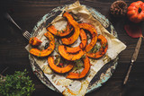 Delicious baked pumpkin with thyme and chilli on the wooden table, top view - 171161956