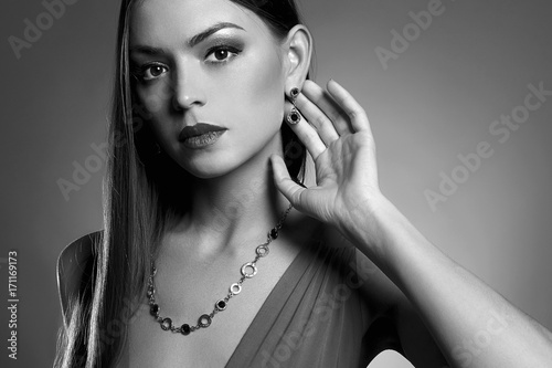 Black and white portrait of woman in jewelry