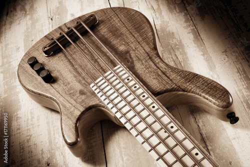 solid body micro bass guitar,sepia image