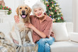 Positive elegant old woman with her pet