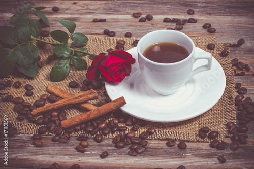 Papiers peints Cafe Black coffee for breakfast and a red rose and cinnamon sticks
