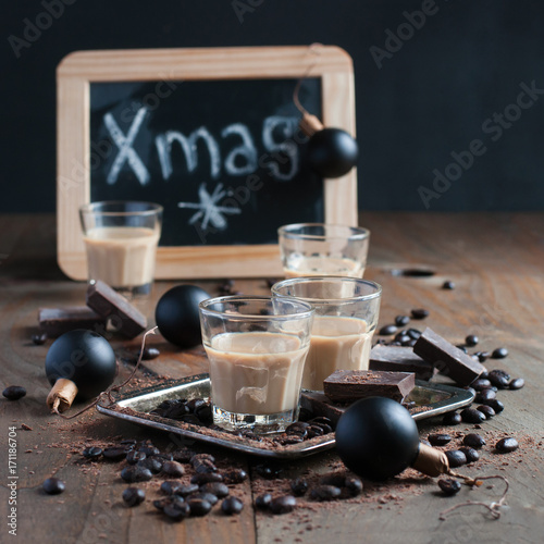 Foto op Aluminium Milkshake Homemade baileys or coffee liqueur in shot glasses, roasted coffee beans and chocolate, Christmas decoration, holidays, selective focus, toned image, square