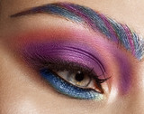 Closeup shot of female eye with colorful eyes shadows and eyelashes makeup. - 171187172
