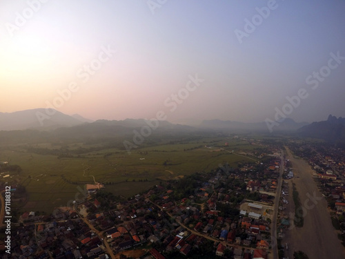 Fotobehang Ochtendgloren Sunrise Hot Air Balloon Ride in Vang Vieng, Laos