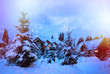 A fairy-tale house in the woods amid the snow-covered fir trees, Christmas landscape. Winter nature.