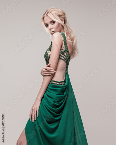 Young, gorgeous model dressed in a wedding or evening style.
