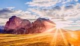 Beautiful autumn mountain scenery in Alps in South Tyrol region of Italian Dolomite Alps. View on mountain ridge. Trentino Alto Adidge, Italy, Alpe di Siusi - Seisser Alm. Fall season scene.