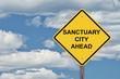 Caution Sign Blue Sky - Sanctuary City Ahead