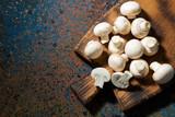 fresh organic mushrooms on vintage cutting board, top view