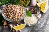 fresh ingredients for preparing hummus on wooden background, top view