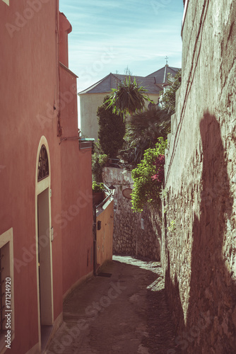 Foto op Canvas Smal steegje Narrow alleys, historical old ancient town in Italy, architectural details, toned image, vintage filter, split toning.