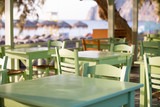 Tables and chairs in a street restaurant in Kamari on Santorini - 171220114