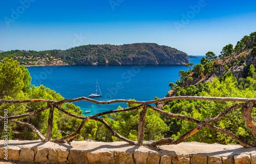 Foto op Plexiglas Cyprus Idyllic island scenery bay with boat at the bay of Camp de Mar on Majorca island, Spain