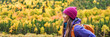 Autumn hiker backpacking in forest nature banner panorama. Woman trail hiking in mountain hike. Girl outdoor lifestyle.