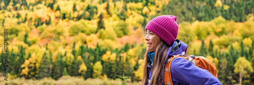 Fotobehang Hoogte schaal Autumn hiker backpacking in forest nature banner panorama. Woman trail hiking in mountain hike. Girl outdoor lifestyle.