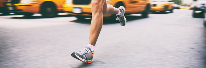 Runner athlete running in city street banner. Sport man training outside in urban background next to yellow cabs cars taxi in new york NYC.