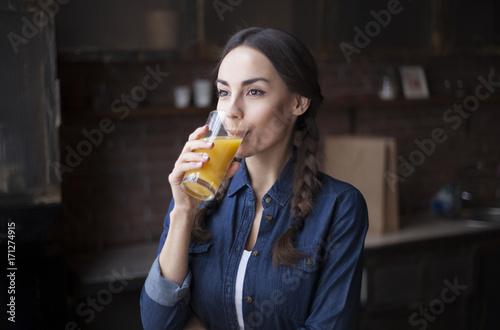 Foto op Plexiglas Sap Healty lifestily with fresh juice. Girl drinks fresh