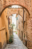 Beautiful narrow street in Montepulciano in Tuscany Italy. Montpulciano is famous for its wine.