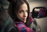 smiling young woman portrait sit in car leaning on window - 171276751