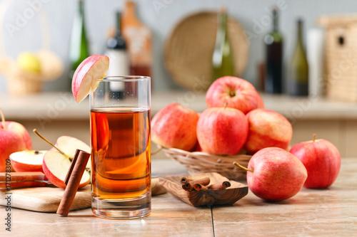 Fotobehang Sap Glass of apple juice and ripe pink apples