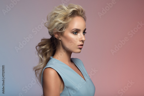 Fashion portrait of beautiful woman. Colorful background.