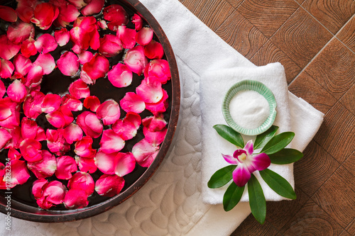 Papiers peints Pedicure Spa pedicure treatment with foot bath in bowl, red rose petals ,orchid,foot scrub , top view