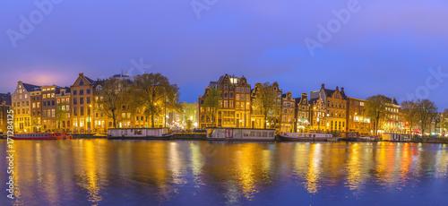Papiers peints Amsterdam Amsterdam sunset panorama city skyline at canal waterfront, Amsterdam, Netherlands