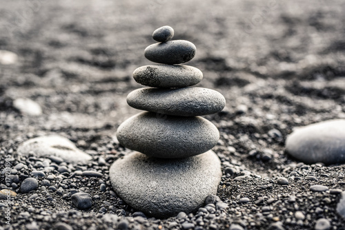 Poster Stenen in het Zand Stones stacked on top of a black beach in Iceland.