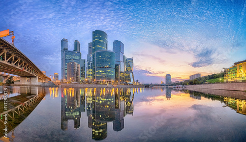 Fotobehang Moskou Cityscape of Moscow city business district reflecting in Moskva river in the morning