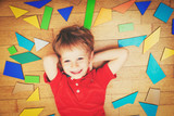 happy little boy with puzzle toys, early child development