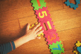 child playing with puzzle, education concept - 171298760