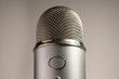 Macro Silver Microphone on White Background