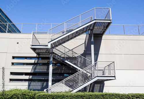 Metal and glass stairs in the building, modern style