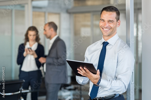 Wall mural Successful businessman at office