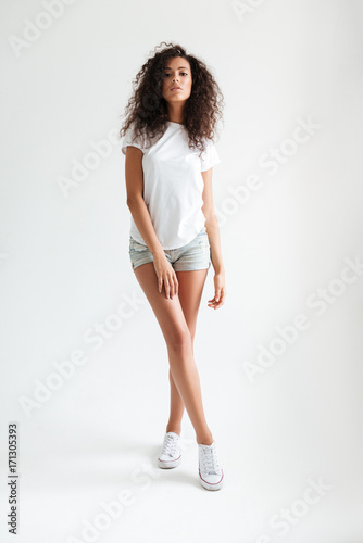 Full length portrait of a casual young woman posing