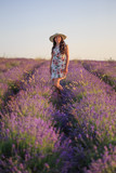 Romantic woman among blooming lavender - 171305743