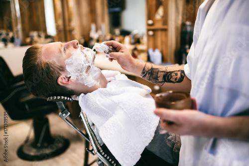 Male receiving hair beard treatment Plakat