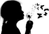 girl silhouette blowing on black dandelion