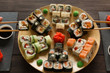 Eating set of sushi maki and rolls in japanese resaturant