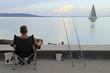 man is fishing at lake Balaton in Tihany, Hungary
